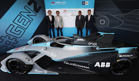 The_group_posing_alongside_the_next_generation_Formula_E_car.jpg